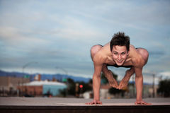 Homem novo que faz a ioga Imagem de Stock Royalty Free