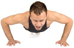 Homem novo que faz o exercício, Foto de Stock Royalty Free