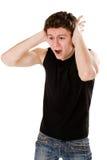 Homem novo que grita Imagens de Stock