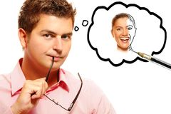 Homem novo que imagina sua mulher perfeita Imagem de Stock