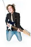 Homem novo que joga a electro guitarra Foto de Stock Royalty Free