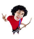 Homem novo que joga a guitarra sobre o fundo branco Imagens de Stock