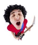 Homem novo que joga a guitarra sobre o fundo branco Fotografia de Stock Royalty Free