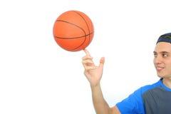 Homem novo que joga o basquetebol isolado imagem de stock royalty free