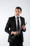 Homem novo que joga o clarinete Fotos de Stock Royalty Free