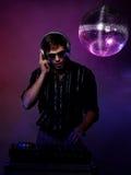 Homem novo que joga o DJ Imagens de Stock