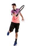 Homem novo que joga o tênis fotografia de stock royalty free
