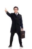Homem novo que mantém a mala de viagem isolada no branco Imagem de Stock Royalty Free