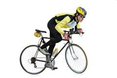 Homem novo que monta uma bicicleta fotografia de stock royalty free