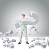 Homem com pontos de interrogação Fotografia de Stock