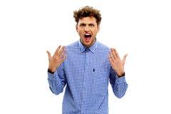 Homem novo que olha muito entusiasmado Foto de Stock Royalty Free