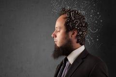 Homem novo que pensa com linhas e símbolos abstratos Fotografia de Stock Royalty Free