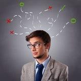 Homem novo que pensa com marcas em cima Foto de Stock