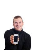 Homem novo que prende o telefone móvel Imagens de Stock