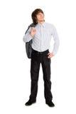 Homem novo que prende seu revestimento que olha acima Fotos de Stock