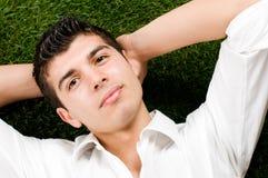 Homem novo que relaxa Imagem de Stock Royalty Free