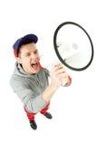 Homem novo que shouting através do megafone Imagem de Stock Royalty Free