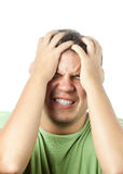 Homem novo que tem a dor muito forte isolada Imagens de Stock