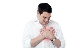 Homem novo que tem o cardíaco de ataque Imagem de Stock