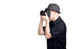 Homem novo que toma uma foto Fotografia de Stock