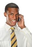 Homem novo que usa o telefone celular Foto de Stock Royalty Free
