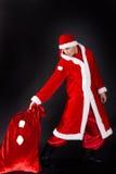 Homem novo que veste como Papai Noel. Foto de Stock