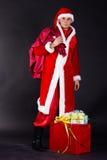 Homem novo que veste como Papai Noel. Foto de Stock Royalty Free