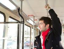 Homem novo que viaja pelo transporte público Fotos de Stock Royalty Free