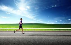 Homem novo running Imagem de Stock Royalty Free