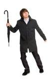 Homem novo Running em um raincoat Imagem de Stock