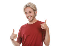 Homem novo satisfeito que dá o polegar acima Imagem de Stock Royalty Free
