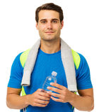 Homem novo seguro com toalha e garrafa de água Fotografia de Stock
