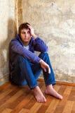 Homem novo triste fotografia de stock royalty free