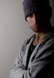 Homem novo triste em um chapéu Foto de Stock Royalty Free