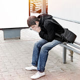 Homem novo triste exterior Imagem de Stock Royalty Free