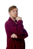 Homem novo vestido em uma camiseta marrom Imagem de Stock