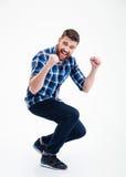 Homem ocasional feliz que comemora seu sucesso Fotografia de Stock Royalty Free