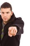 Homem ocasional novo que aponta com seu dedo Imagens de Stock Royalty Free