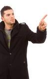 Homem ocasional novo que aponta com seu dedo Fotografia de Stock