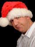 Homem olhando de sobrancelhas franzidas do Natal Imagens de Stock