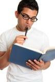 Homem ou estudante que pondering ou que pensam atenta fotografia de stock