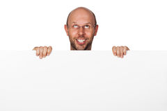 Homem parvo engraçado que guarda o sinal Fotografia de Stock Royalty Free