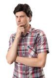 Homem pensativo isolado sobre o fundo branco Fotografia de Stock