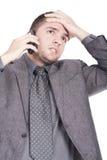 Homem preocupado que fala no telefone Imagem de Stock Royalty Free