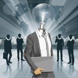 Homem principal da lâmpada com portátil Imagem de Stock Royalty Free