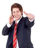 Homem que é positivo no telefone Fotos de Stock Royalty Free