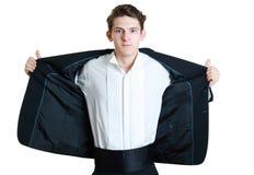 Homem que abre seu terno foto de stock