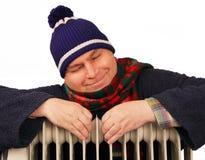 Homem que basking no calefator. Fotos de Stock