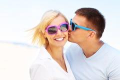 Homem que beija uma mulher imagem de stock royalty free