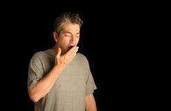 Homem que boceja Fotografia de Stock Royalty Free